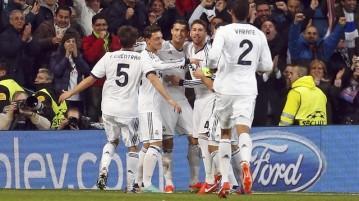(Ronaldo e companhia comemoram o primeiro dos três gols em Madrid\Foto: Reuters)
