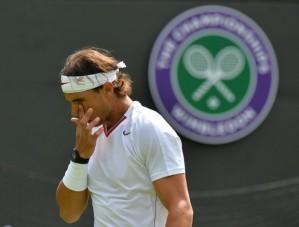 Nadal foi eliminado na estreia em Wimbledon (Foto: AFP)